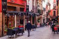 Pedestrian street in Madrid crowded with restaurants and bars that it is visited by locals and tourists