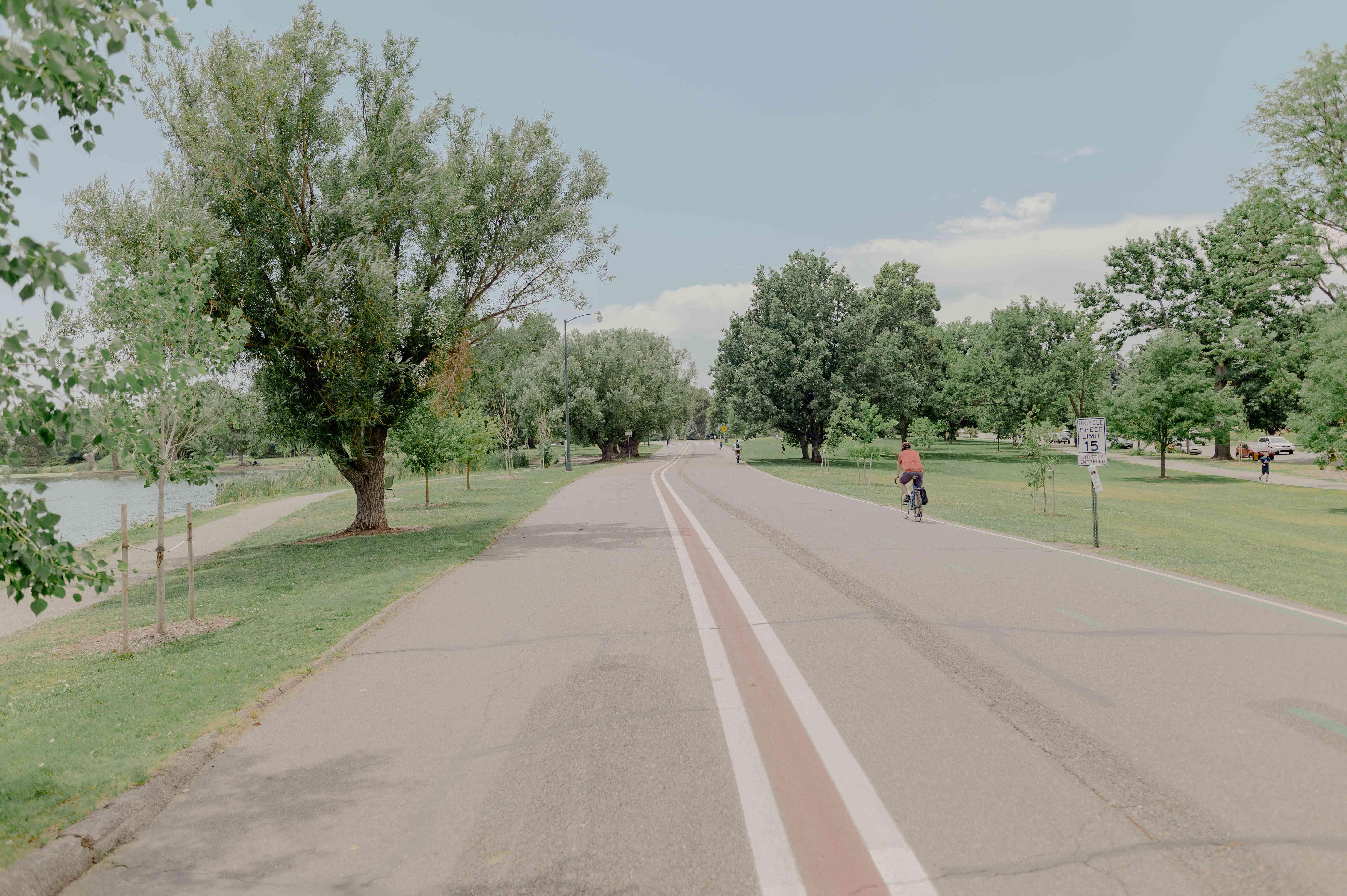 People biking in Washington Park in Denver
