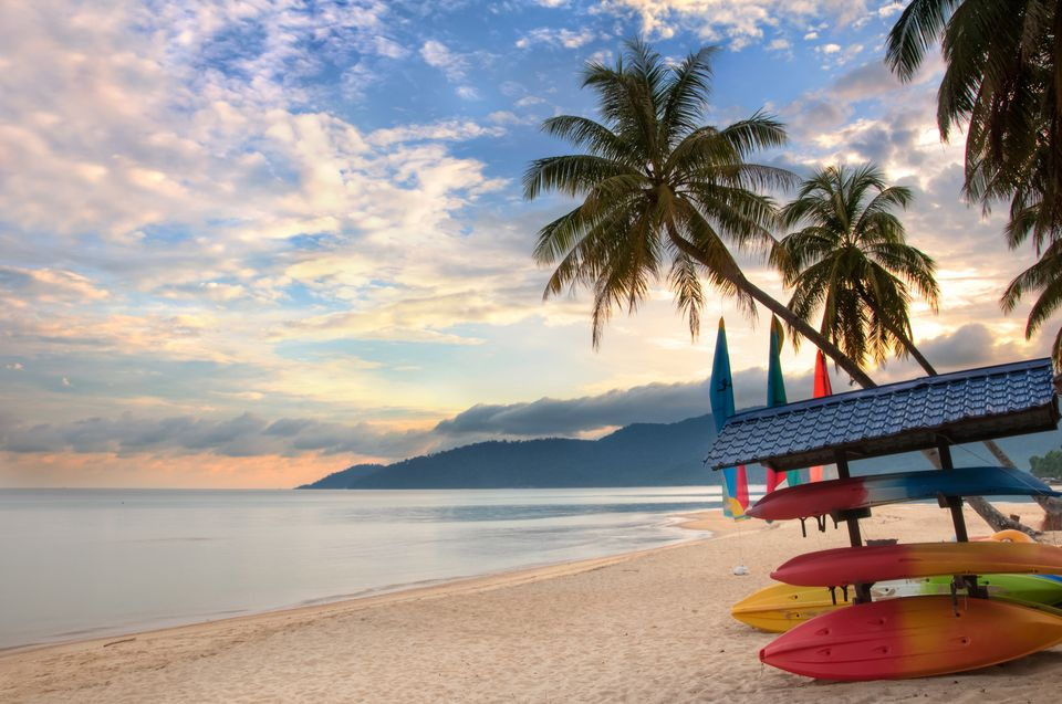 Beach with palm trees at sunrise on Tioman Island