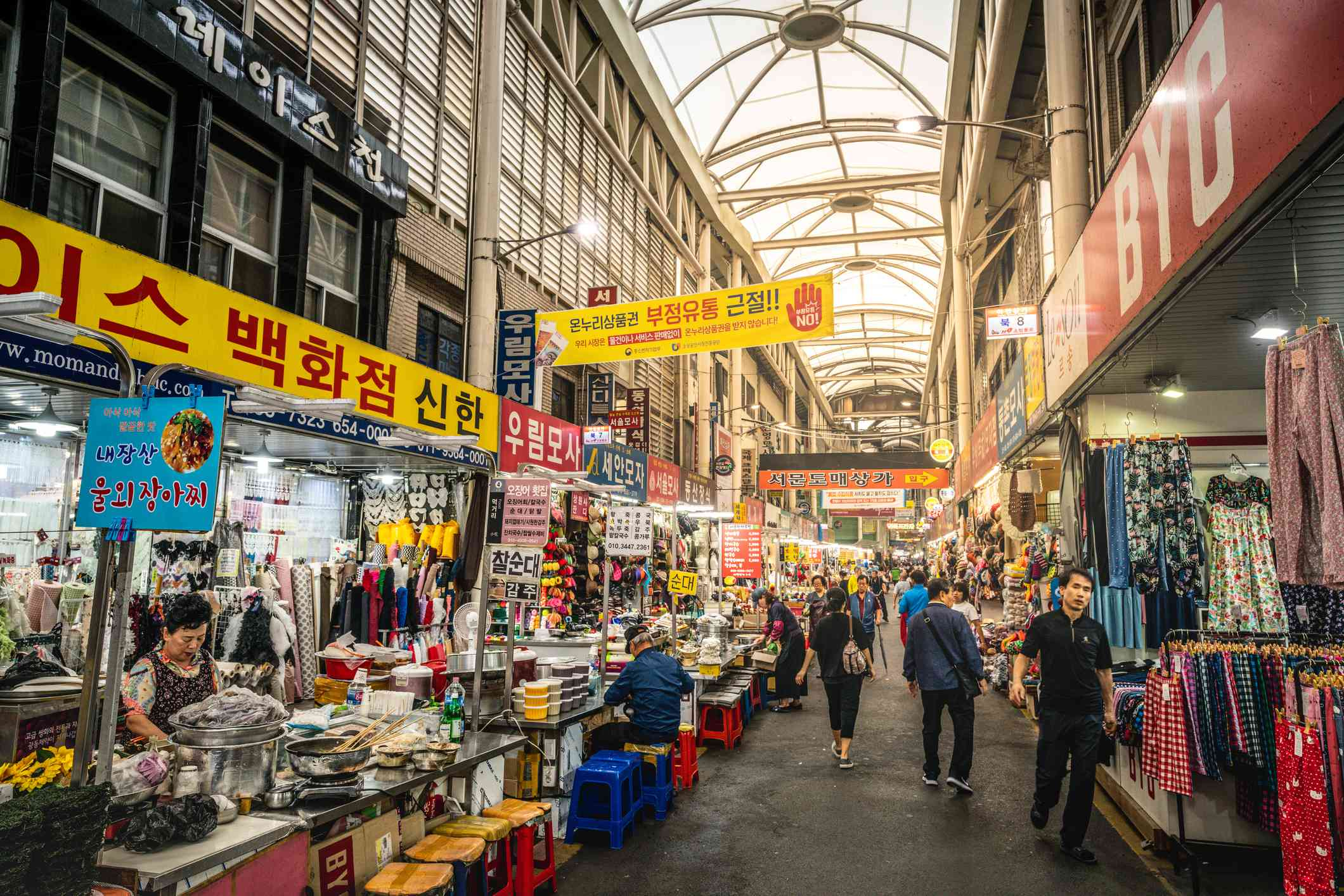 Daegu Seomun covered market during daytime alley view with food and clothes stalls and people in Daegu South Korea