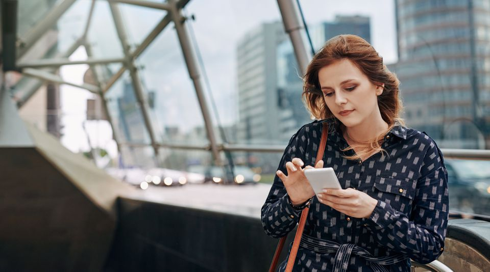 woman using a city hotspot on her cell phone