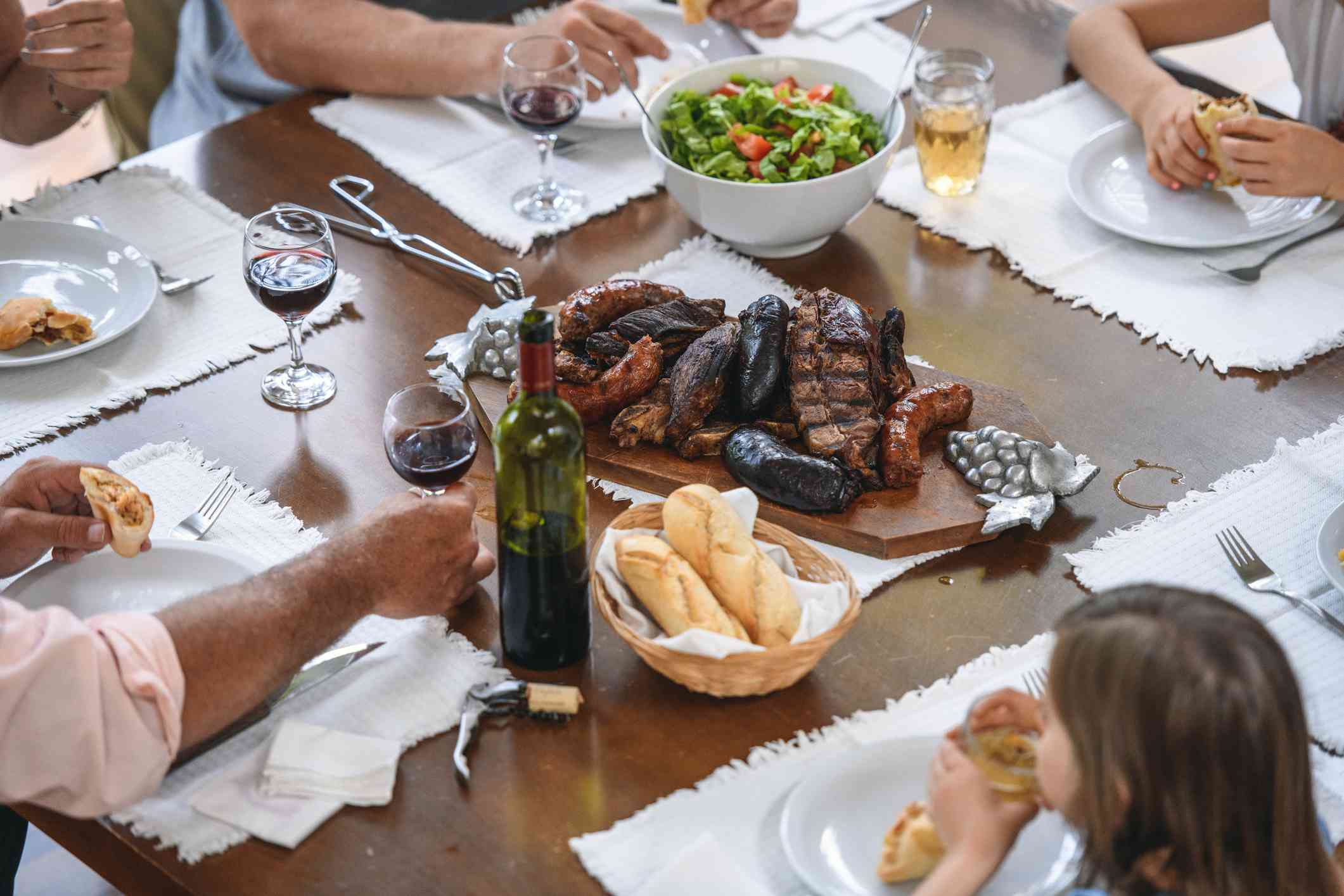 Traditional Argentine Asado Midday Meal on Dining Table
