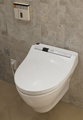 TOTO Toilets Deluxe Hotel Home Johns With A Built In Spritzer Dryer