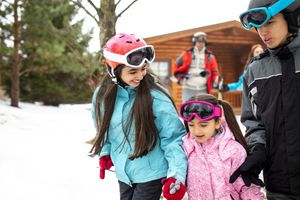 Family walking through the snow