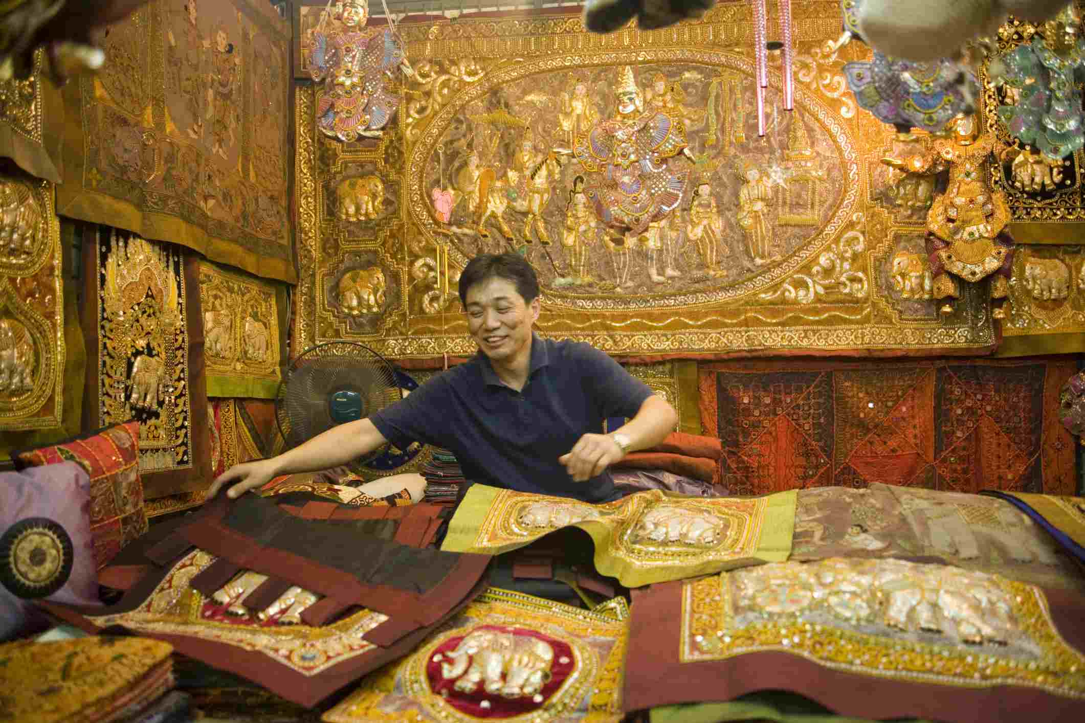 A merchant showing his goods, Suan Chatuchak Weekend Market, Bangkok, Thailand