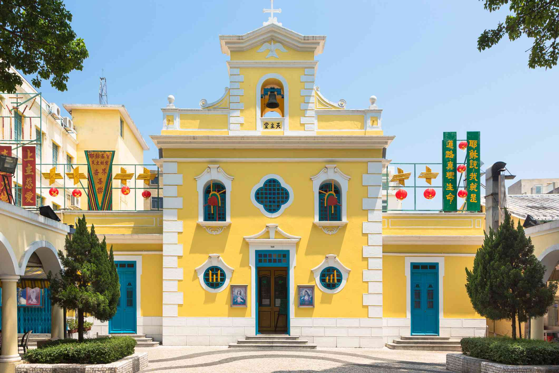 yellow church of St. Francis Xavier in the charming village of Coloane in Macau.