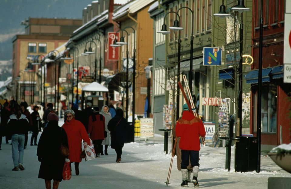 MALE SKIER ON MAIN STREET, LILLEHAMMER, NORWAY