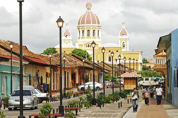 Calle La Calzada and Cathedral de Granada in the background
