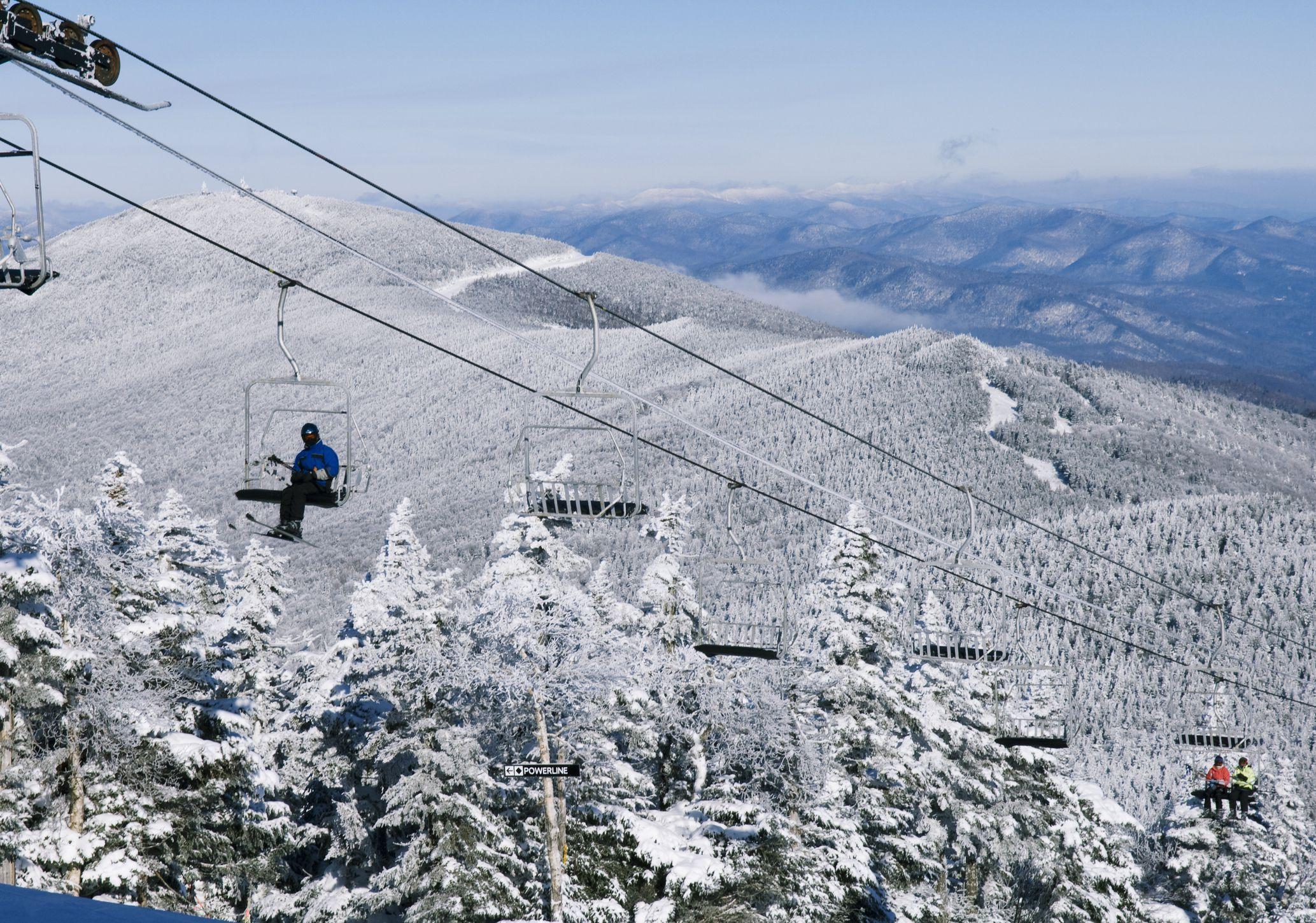 Ski gondolas ascending the slopes, Killington Ski Resort., Vermont
