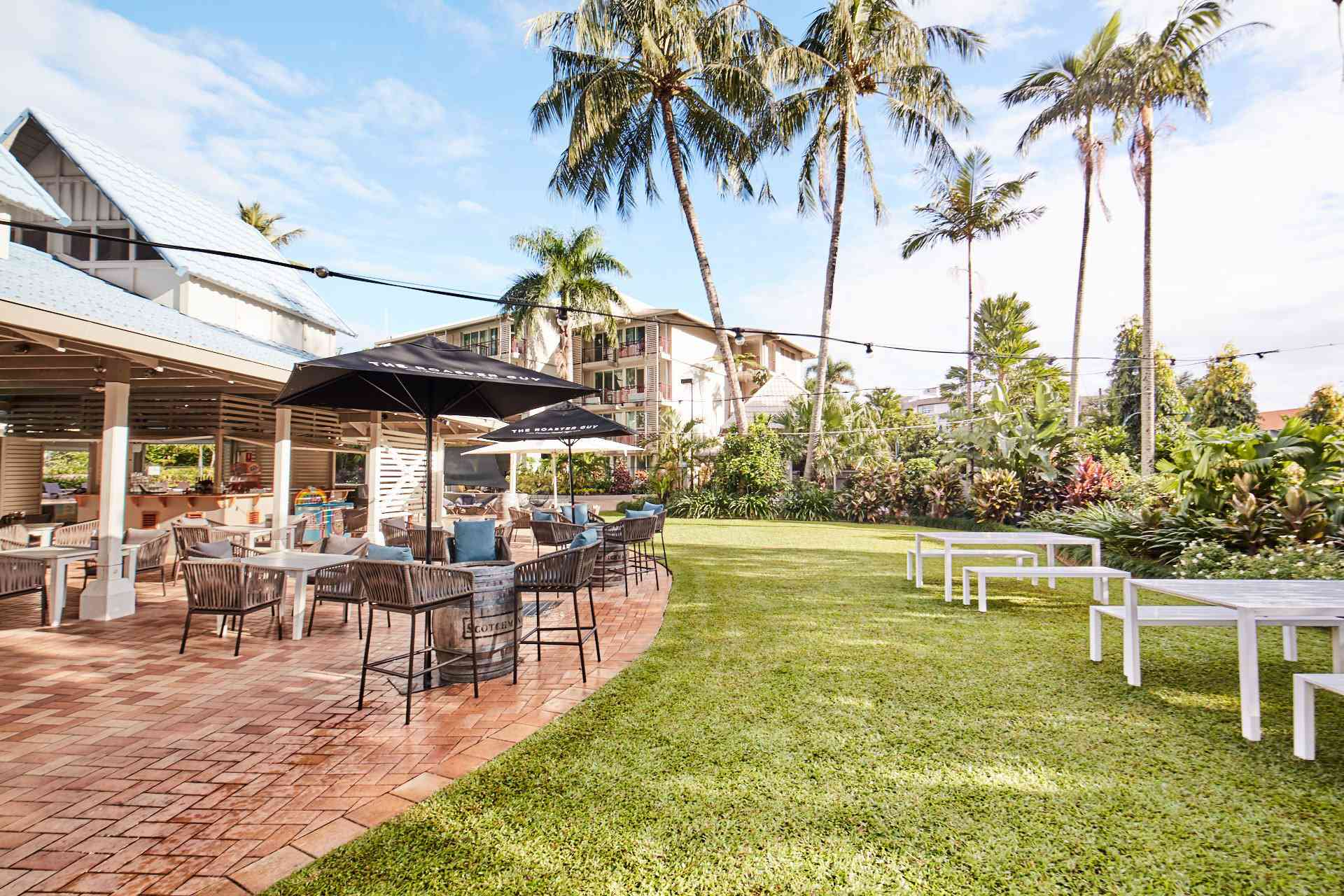Outdoor dining area with palm trees