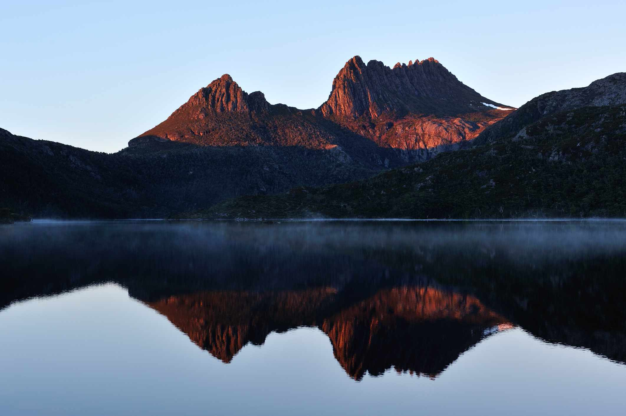 Reflection of Cradle Mountain in a misty lake
