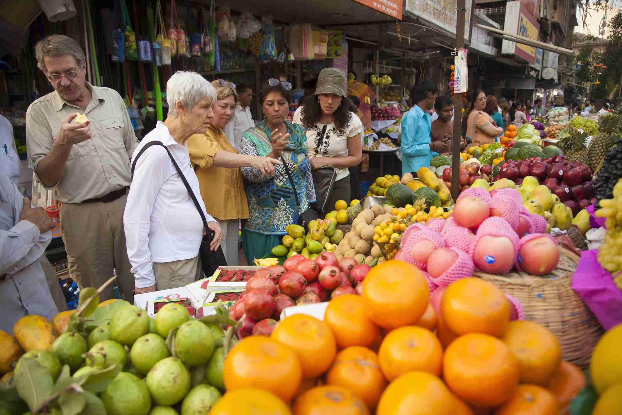 Tourists vegetable market on a street in Mumbai, India.