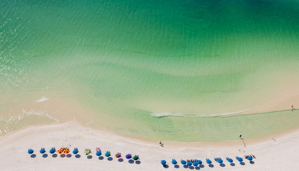 Beach umbrellas on beach, Destin, Florida, USA