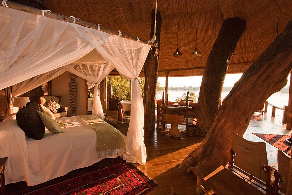 Luxury treehouse accommodations at Tongabezi in Zambezi.