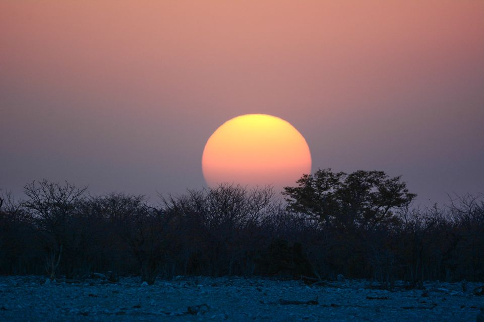 Namibia landscape with a very colorful sun setting