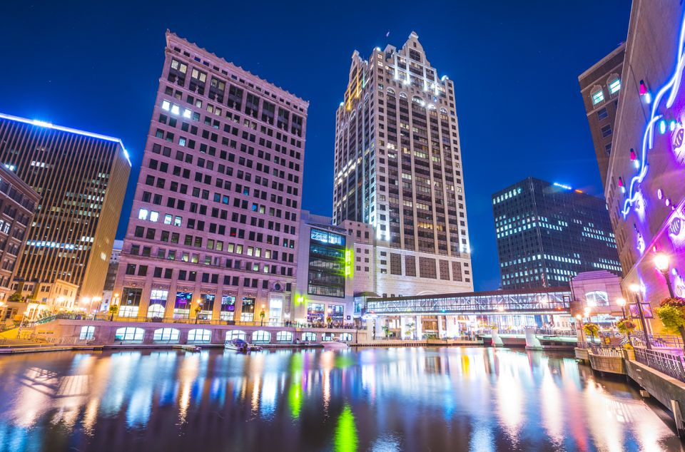 milwaukee downtown with reflection in water at night,milwaukee,wisconsin,usa.