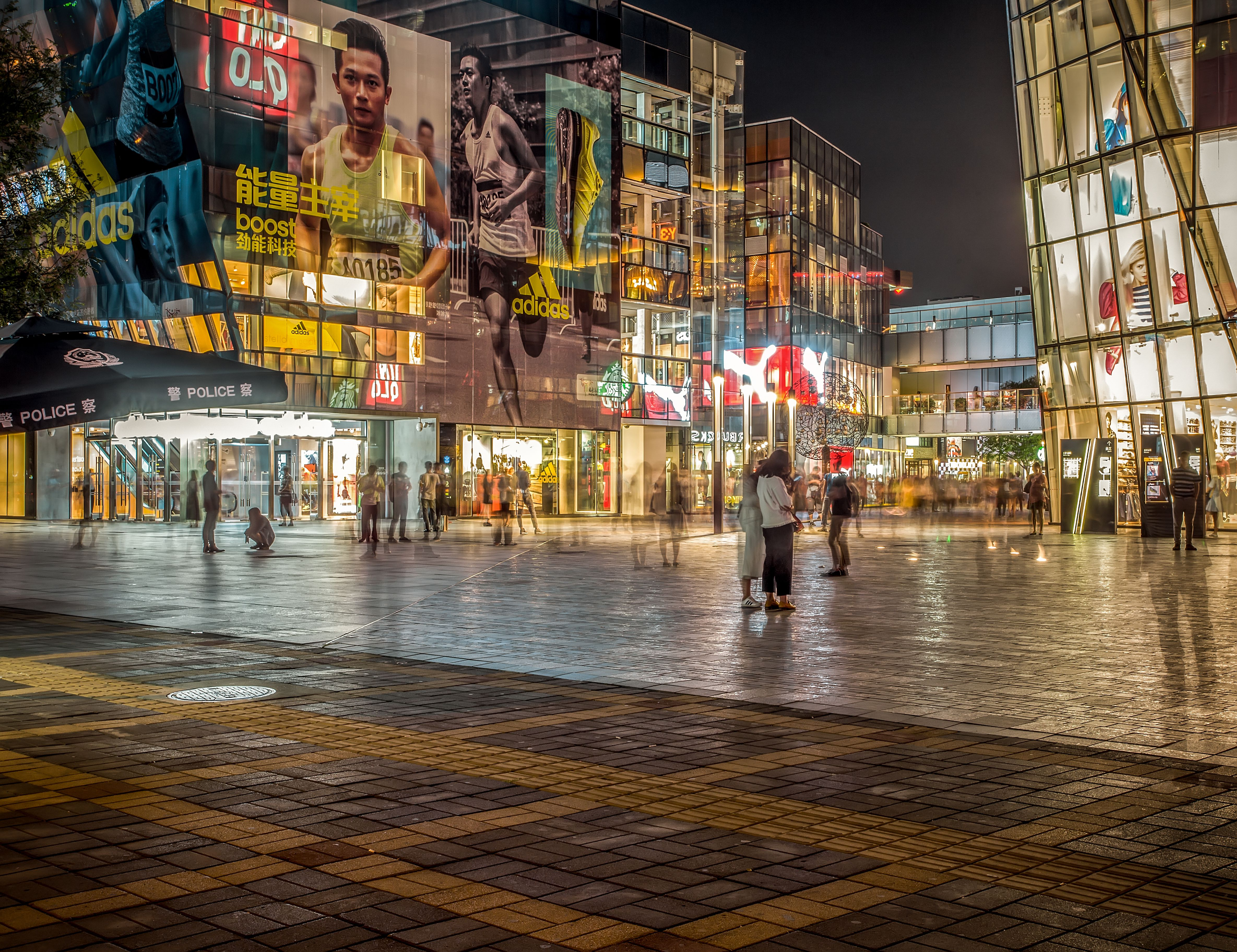 Glowing shops at night in the Sanlitun district of Beijing