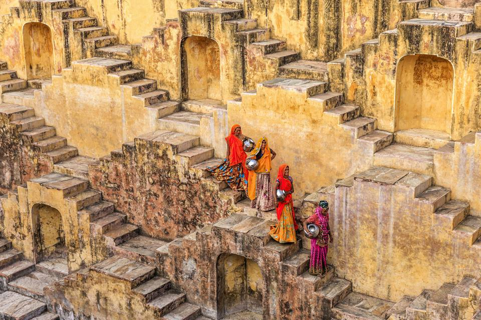 Indian women carrying water from stepwell near Jaipur.