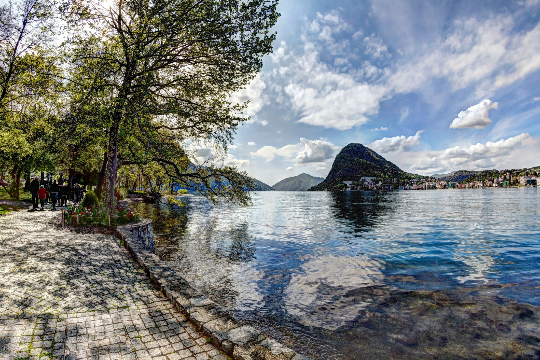 Scenic View Of Mountains By Lake Lugano Against Sky