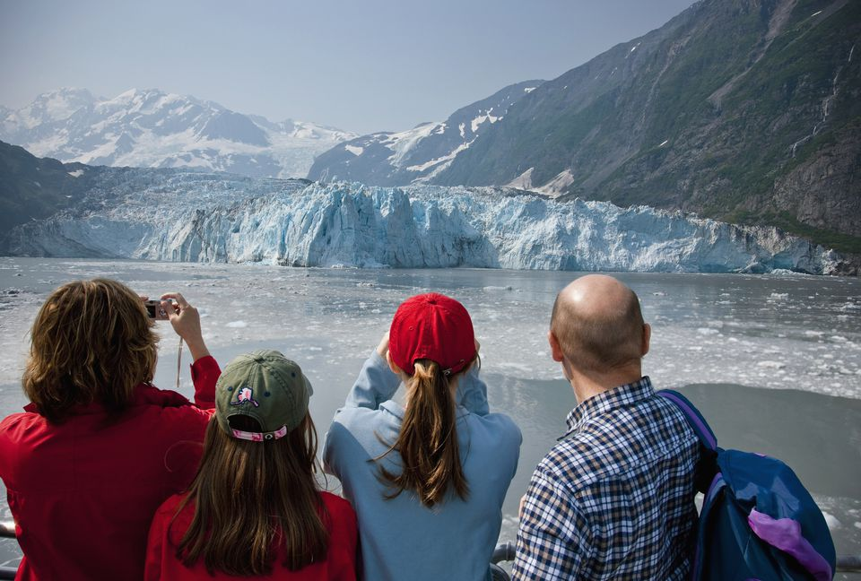 Family Sightseeeing While On A Day Cruise In Prince Wiliam Sound With Harriman Glacier In The Background, Southcentral Alaska, Usa