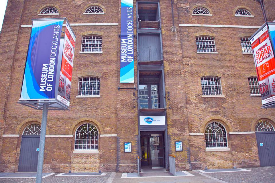 The brick facade of the entrance to the Museum of London Docklands