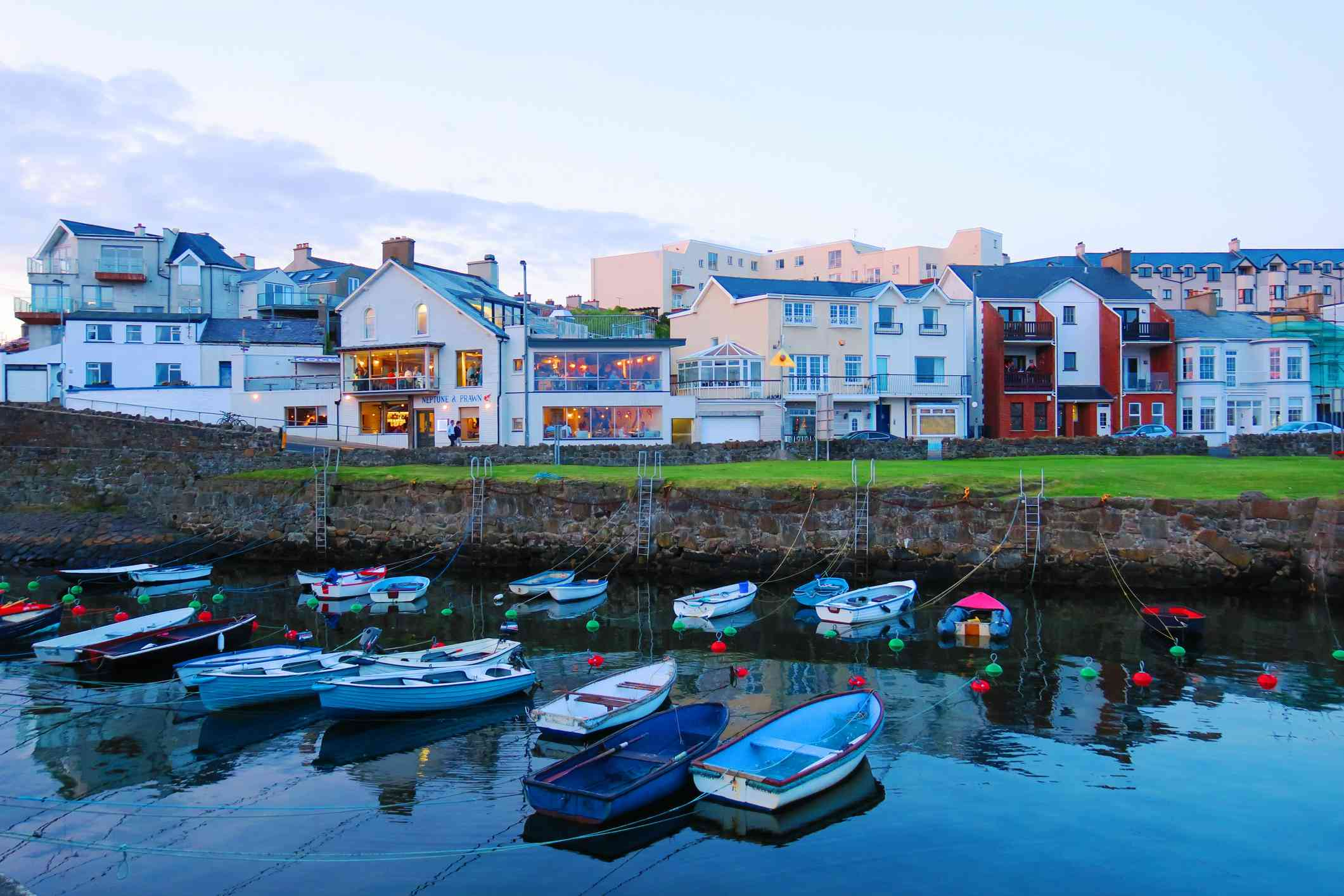 Seaside town of Portrush with empty boats floating in the water