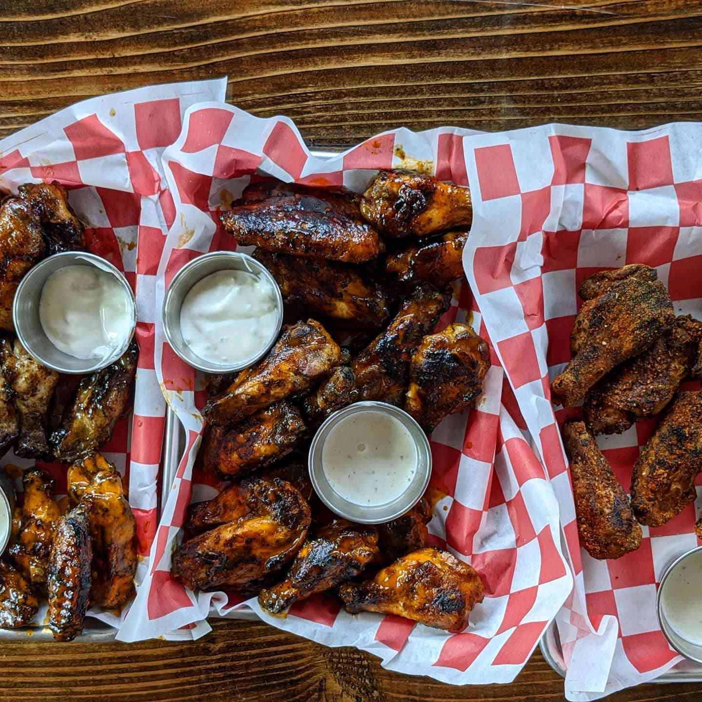 Three baskets of chicken wings