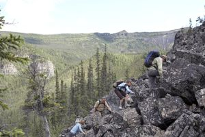Hikers climbing rocky area in Canada