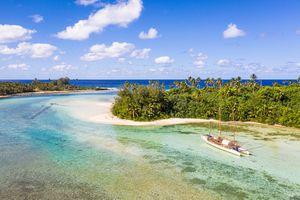 Sailboat in the idyllic Muri lagoon in rarotonga in the Cook islands in Polynesia south Pacific