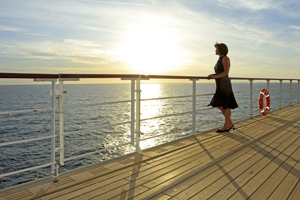 Woman overlooking the dock of a cruise ship