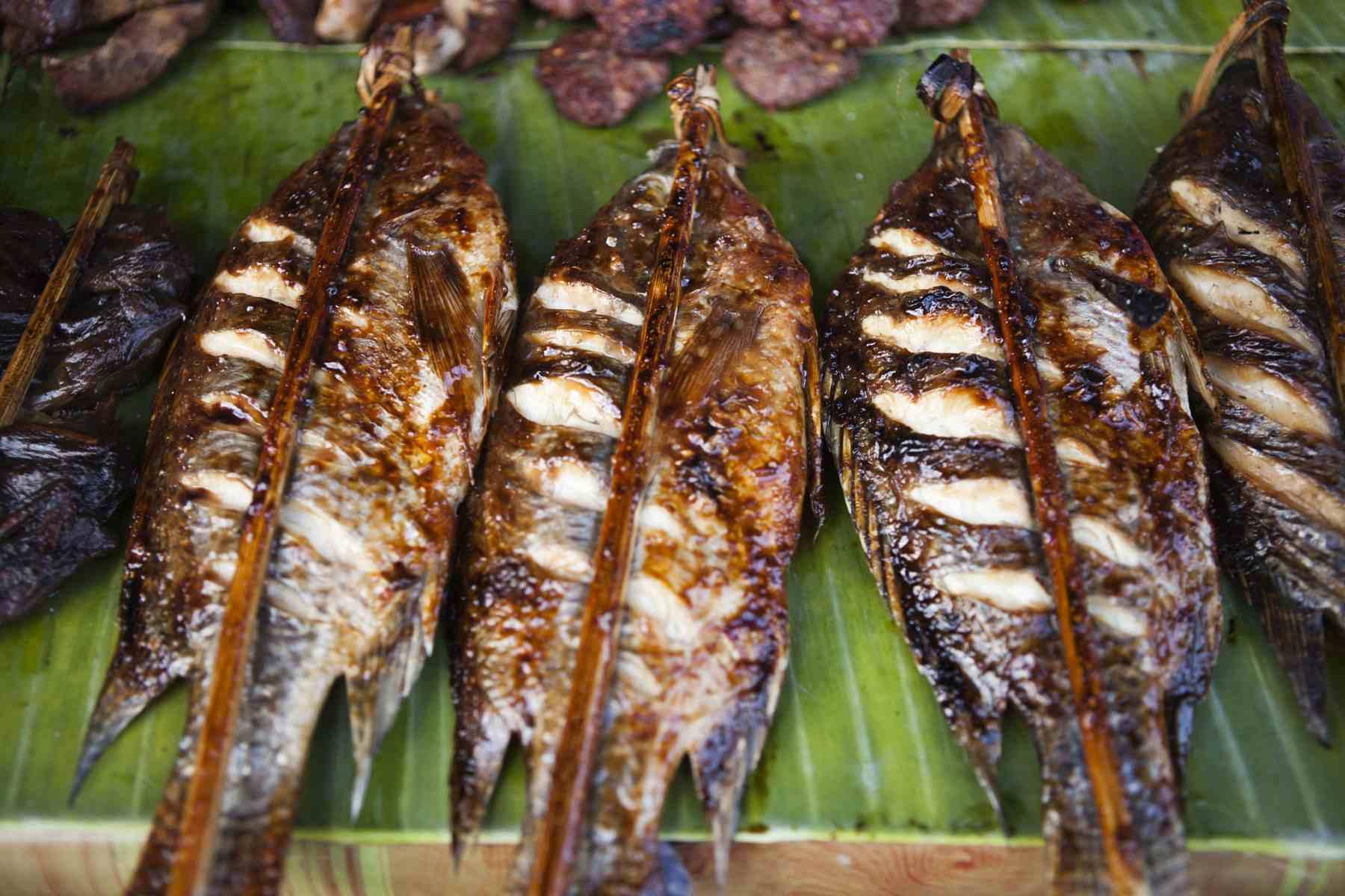 Skewers of ping pa, or roast fish