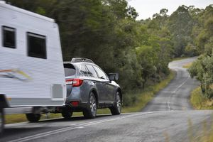 car towing a travel trailer