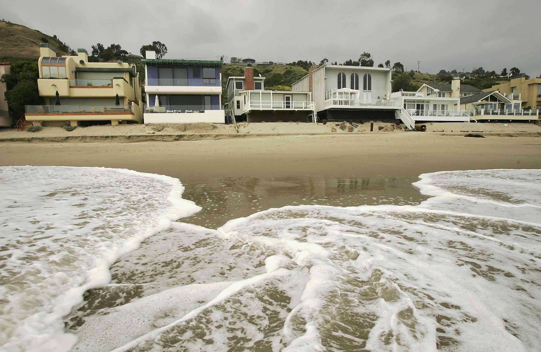 Luxurious beach houses crowd the shoreline at Carbon Beach