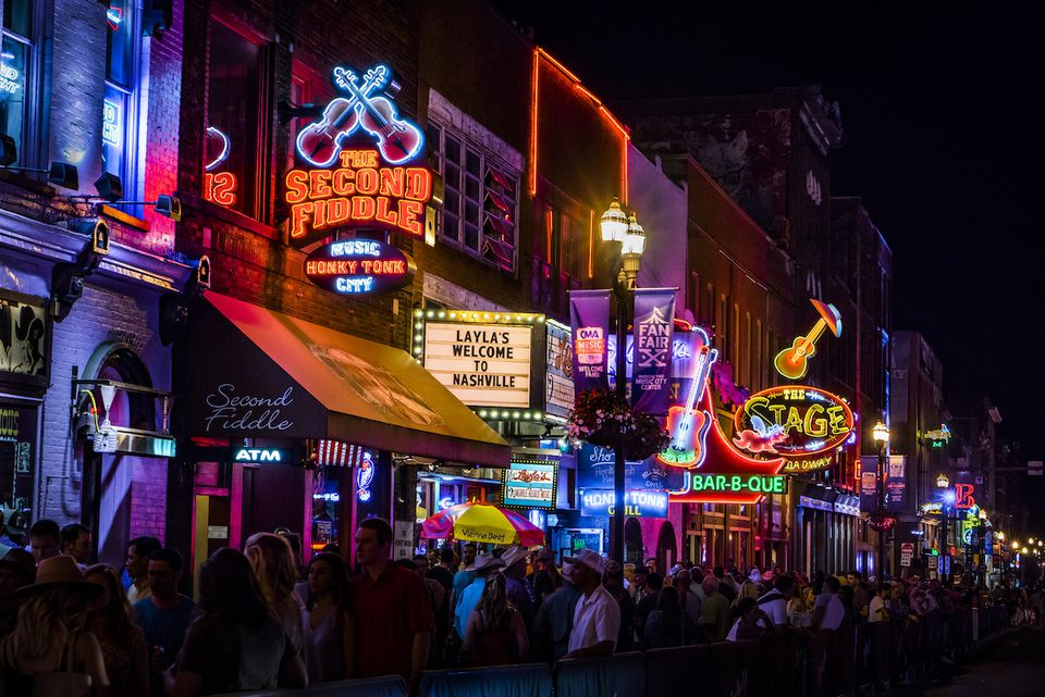 The neon signs of South Broadway light up the night in Nashville
