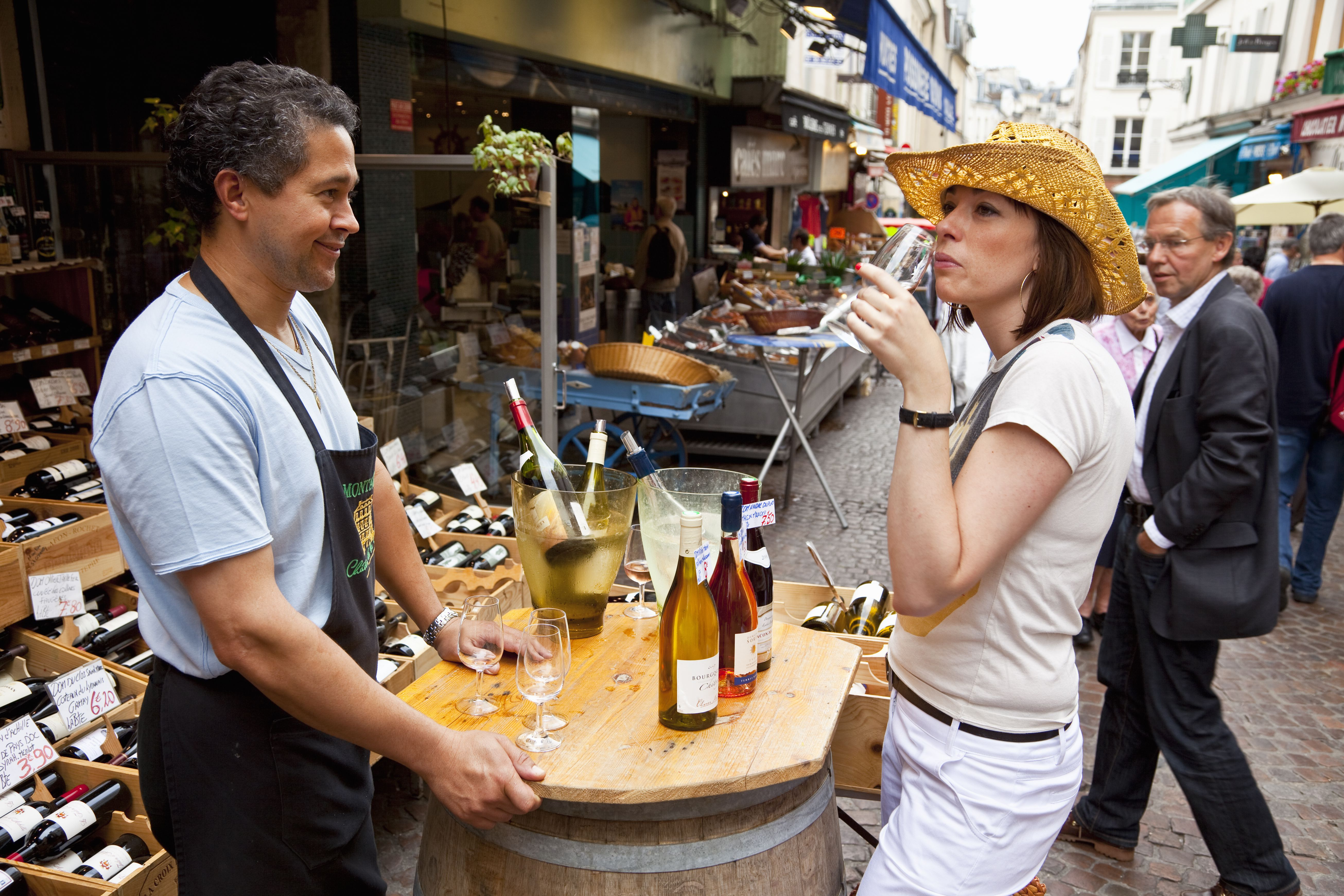 Wine tasting at an outdoor market in Paris.
