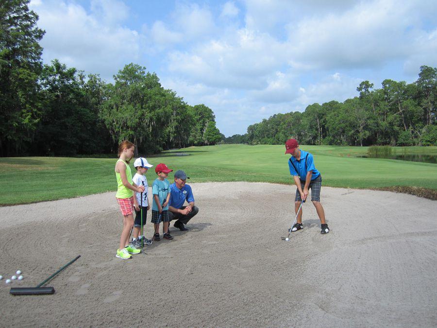 children golfing at disney world