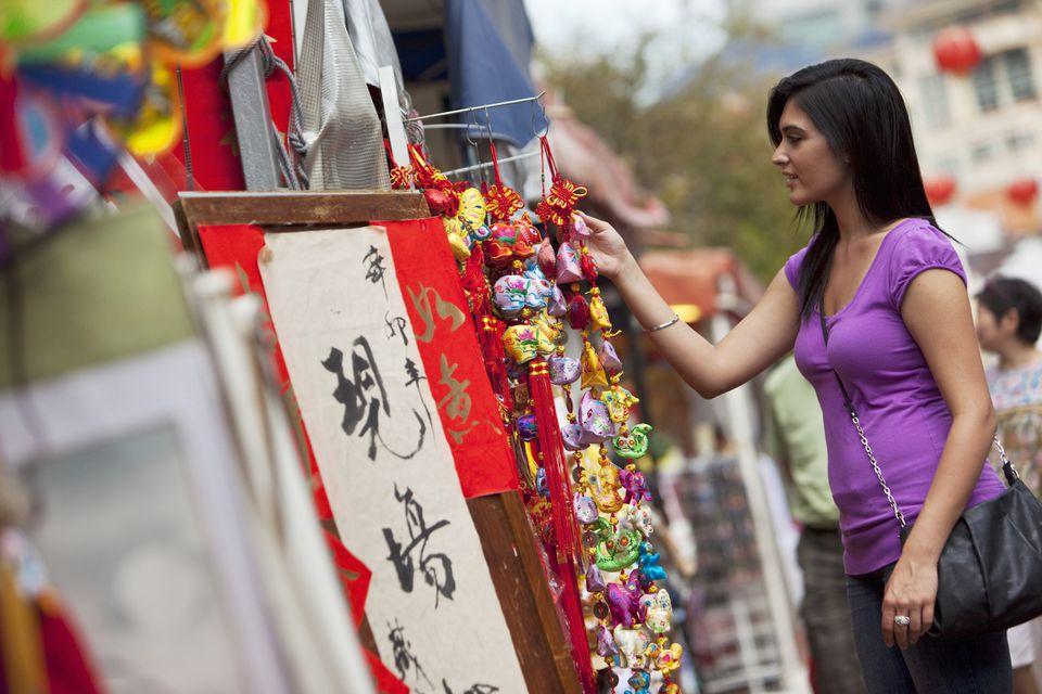 Tourist browsing through souvenirs in Hong Kong