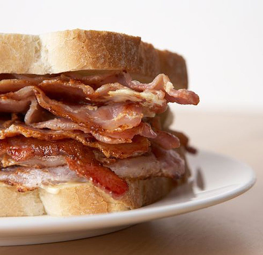 Bacon sandwich in Britain is a bacon sarnie or bacon butty and it's all about the bacon with no extra frills.