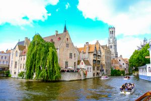 tour boats cruising through canals in Bruges