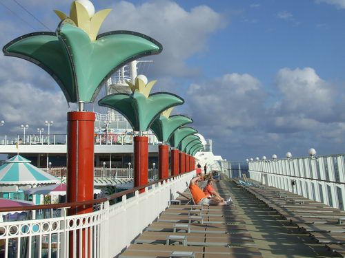 Deck seating is available near the swimming pool on the Norwegian Pearl
