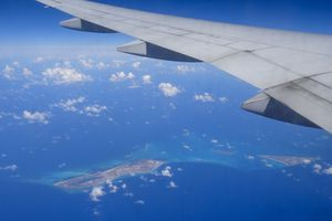 Aerial view of Turks and Caicos Islands and aircraft wing