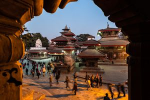 pagoda temples at dusk with people walking in foreground