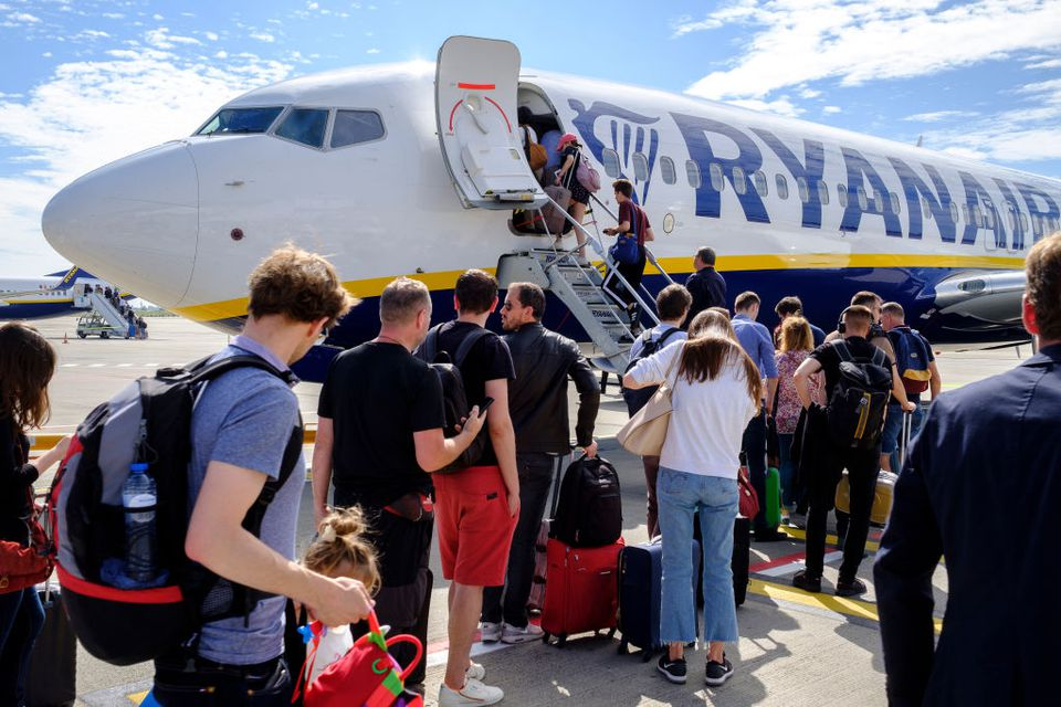 Passengers board a Ryanair flight