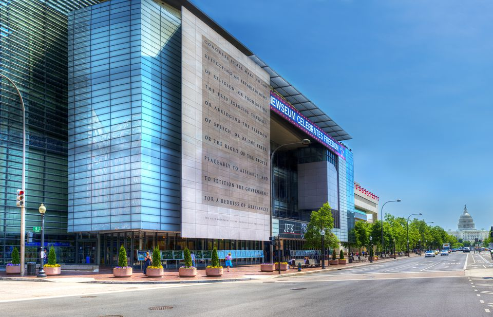 The exterior of the Newseum, with the U.S. Capitol in the background