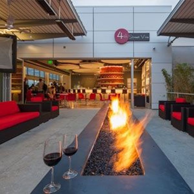 An outdoor seating area at Long Beach Airport.