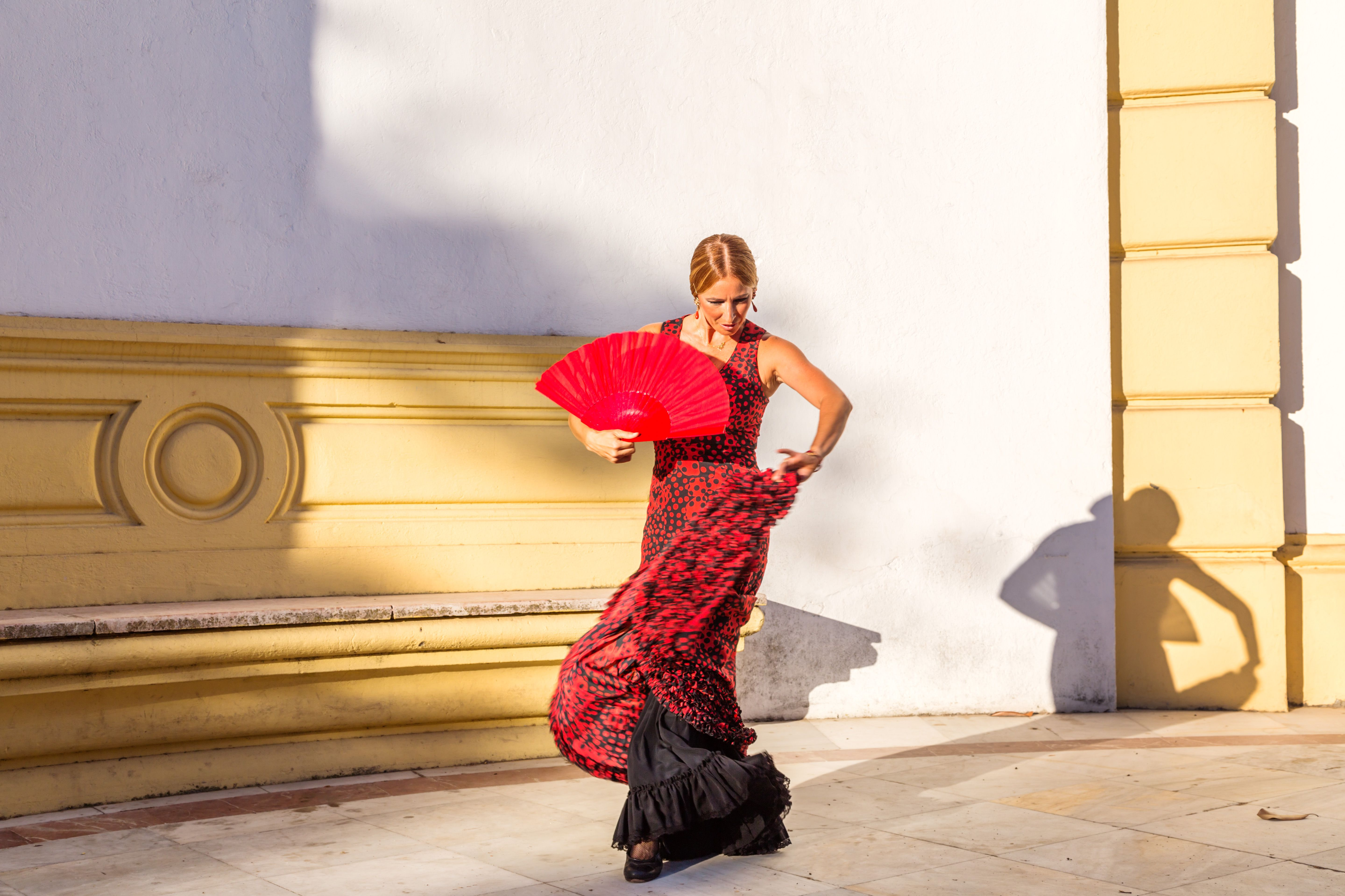 Flamenco dancer performing outdoors in Seville, Andalusia, Spain