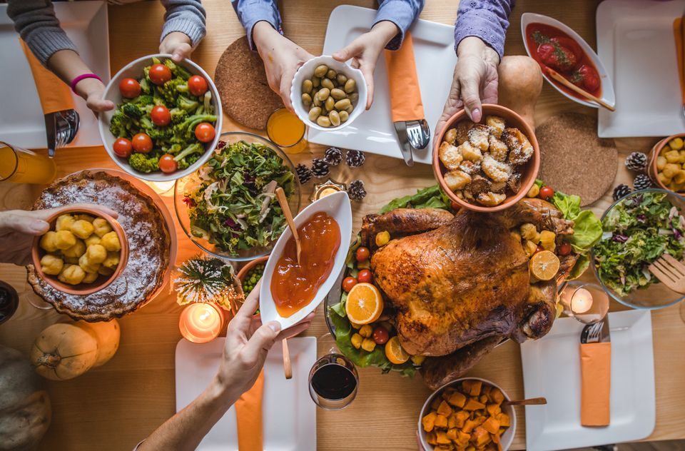 Above view of passing food during Thanksgiving dinner.