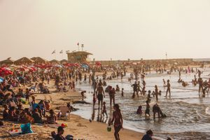 Crowded beach and sunset in Tel Aviv