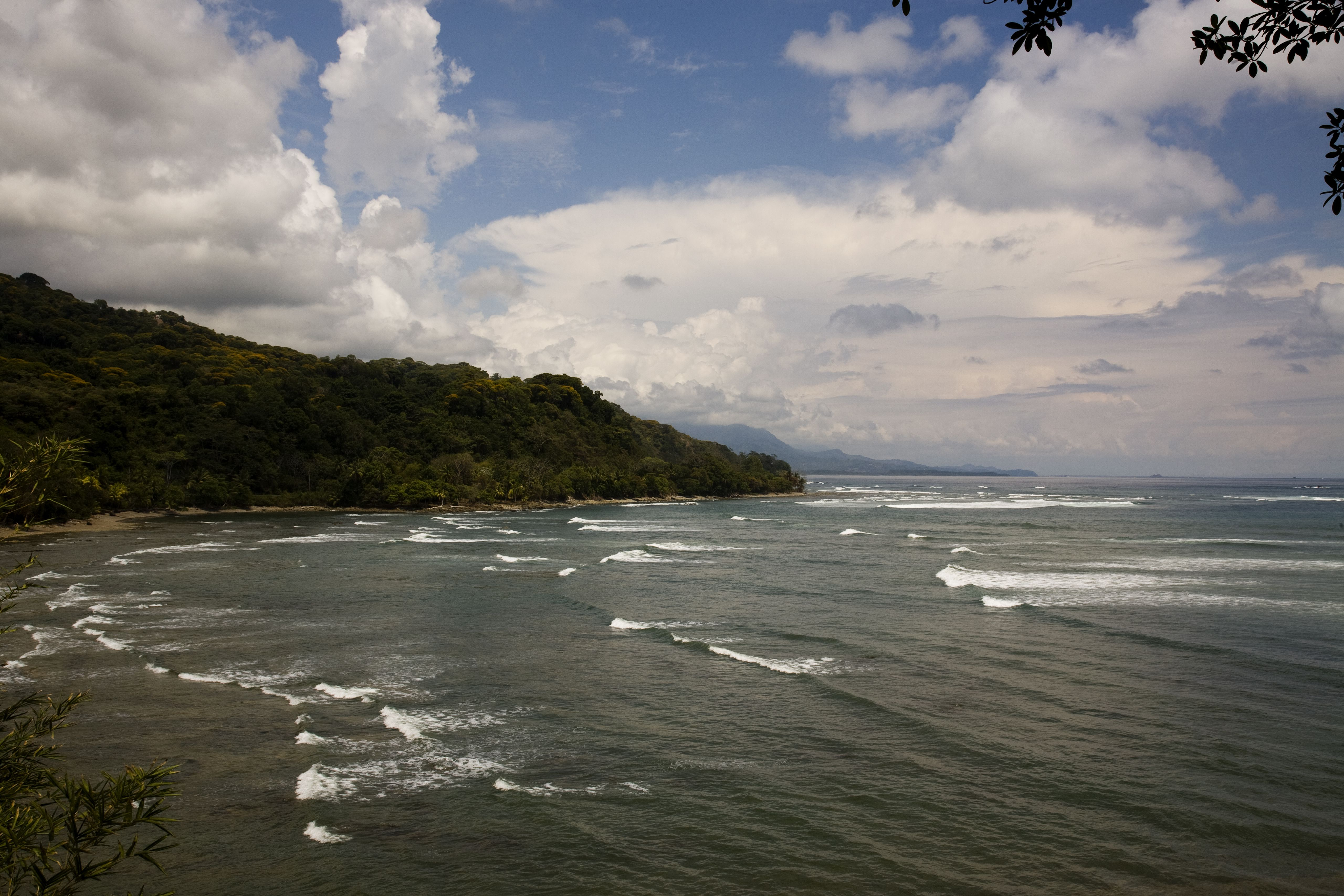 Sets of waves crash into a bay.