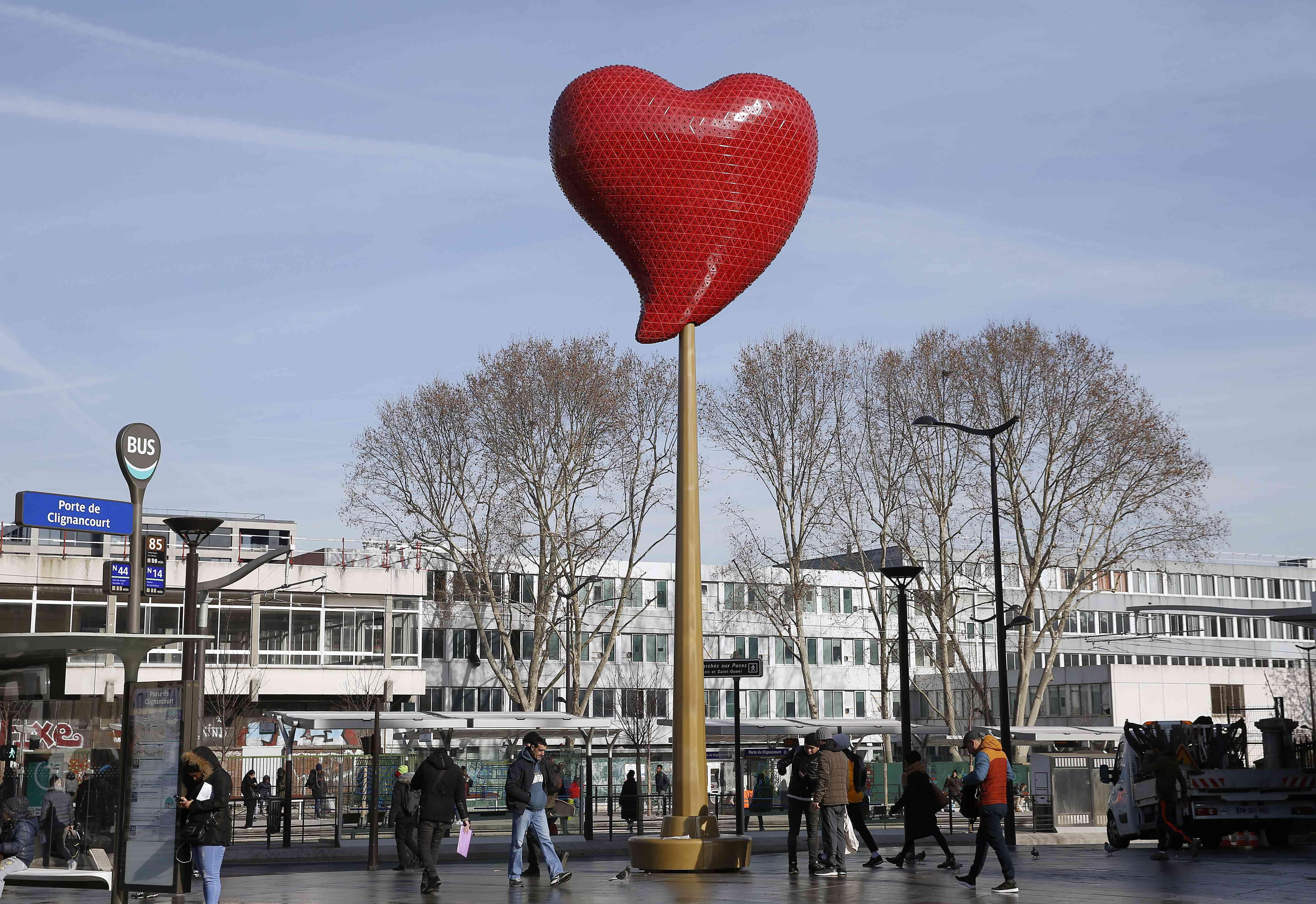 'Le cœur de Paris' by Portuguese artist Joana Vasconcelos is displayed at Porte de Clignancourton the eve of the Valentine's Day in Paris, France.